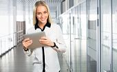 Business woman at office with  tablet computer