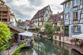 stock photo of petition  - Colorful traditional french houses on the side of river in Petite Venise Colmar France - JPG