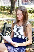 Beautiful young girl in dress outdoors