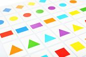 Educational cards with color geometric shapes, close up