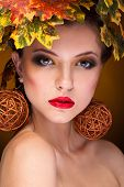 Gorgeous Girl With Autumn Make Up And Leaves