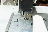 Close-up of sewing machine stitching on patterns
