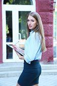 Beautiful businesswoman in dress outdoors