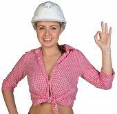 Woman in hard hat making okay gesture