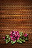rose on a background of brown straw