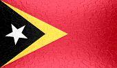 East Timor flag on metallic metal texture