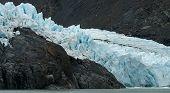 Glacier Moves Over Rock