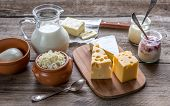 stock photo of milk products  - Various Types Of Dairy Products On The Wooden Background - JPG