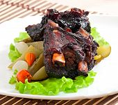 stock photo of marinade  - Baked beef ribs in honey soy marinade with pickled vegetables - JPG