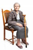 Senior woman with walking stick sitting on chair