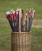 foto of archery  - Colorful archery arrows outdoor in a basket - JPG