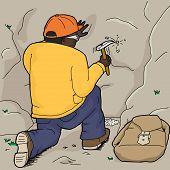 Geologist Using Rock Hammer