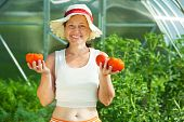 Woman Witrh Tomato In  Hothouse