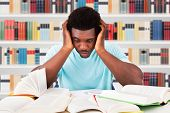 Worried Young African Man Studying