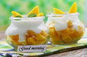 Good morning with healthy yogurt and mango breakfast