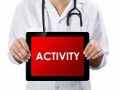 Doctor Showing Tablet With Activity Text.