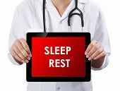 Doctor Showing Tablet With Sleep Rest Text.