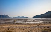 picture of tide  - Ebb tide and small boats at Cat Ba island of Ha Long bay in north Vietnam - JPG