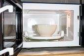 foto of oven  - Image of ceramic bowl in microwave oven for food preparation - JPG