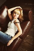 Beautiful Young Woman Lying On Sofa