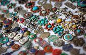 foto of pendulum  - Tibetan pendulums with sacred symbols in the shop in Nepal - JPG
