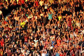 stock photo of hooligan  - Blurred crowd of people in a stadium - JPG