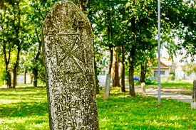 pic of headstones  - Gravestone made of headstone with Maltese cross craved in - JPG