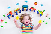 foto of daycare  - Child playing with wooden train - JPG