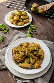 stock photo of roast chicken  - Roasted chicken wings with new potato  - JPG