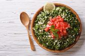 pic of tabouleh  - Tabbouleh salad in a wooden bowl on the table - JPG