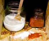 stock photo of cayenne pepper  - Close up of two jars with salt and cayenne pepper in pantry - JPG