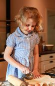pic of pastry chef  - Young girl who is cutting out pastry with pastry cutter - JPG