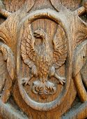 picture of carving  - Carving of an eagle on the old wooden door - JPG