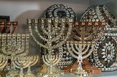 stock photo of hanukkah  - Jewish holiday Hanukkah of silver in the souvenir shop  - JPG