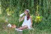 pic of milkmaid  - young Woman Has Picnic In Summer Park - JPG