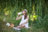 foto of milkmaid  - young Woman Has Picnic In Summer Park - JPG