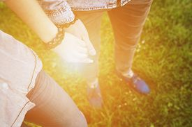 pic of jeans skirt  - Happy couple holding hands in the sunset - JPG