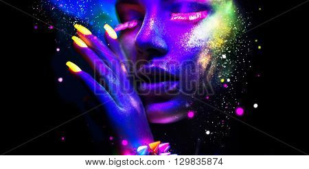 Fashion model woman in neon light, portrait of beautiful model with fluorescent make-up, Art design