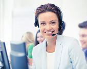 business and call center concept - helpline operator with headphones in call centre poster