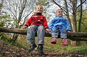 children sit in park