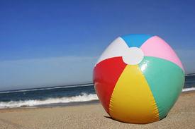 image of beach-ball  - colored beach ball on golden sand beach with blue sky - JPG