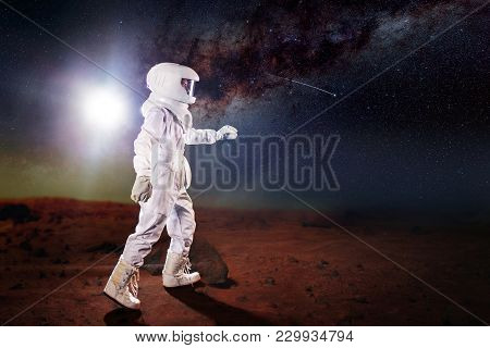 Futuristic Astronaut On The Planet
