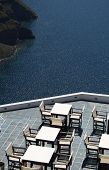 A Summer Cafe Over The Santorini'S Caldera