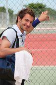 Man stood by tennis court