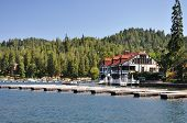 image of dock a pond  - Empty boat docks frame this summertime view of Lake Arrowhead - JPG