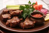 stock photo of red meat  - Shashlik with fresh parsley lemon and sauce - JPG