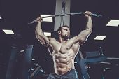 Handsome Model Young Man Training Back In Gym poster