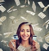 Happy Debt Free Woman Holding A Credit Card Cut In Two Pieces Under Money Rain poster