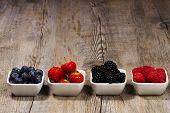 row of wild berries in bowls