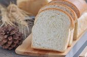 Постер, плакат: Sliced Soft And Sticky Delicious White Bread On Wood Cutting Board Prepare Bread For Breakfast On W